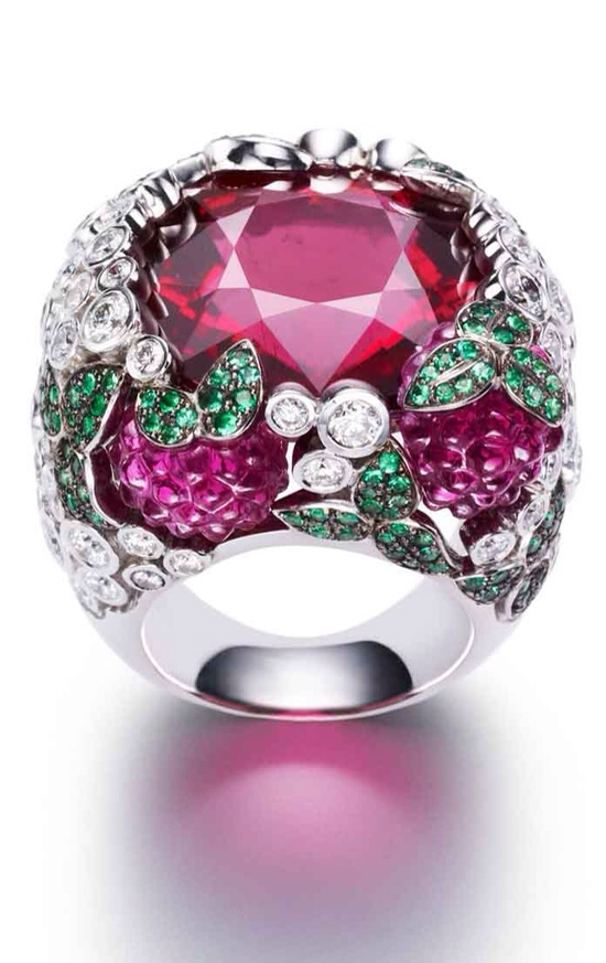 Raspberry daiquiri inspiration ring from the Limelight Cocktail collection in 18K white gold set with 91 brilliant-cut diamonds, 1 cushion-cut rubellite, 3 carved rubellites and 147 round emeralds by Piaget via Haute Tramp Blog