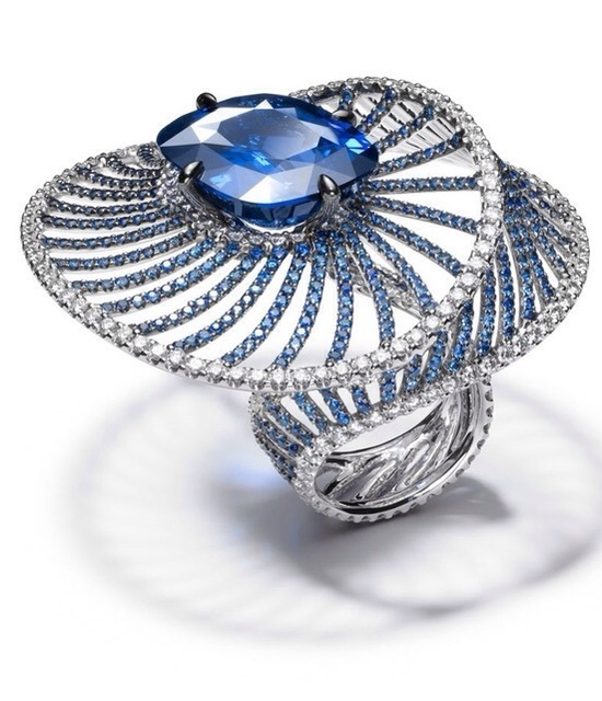 Harmony Ring-25ct cushion-cut sapphire, surrounded by sapphires and diamonds by Adler Jewelry via Haute Tramp