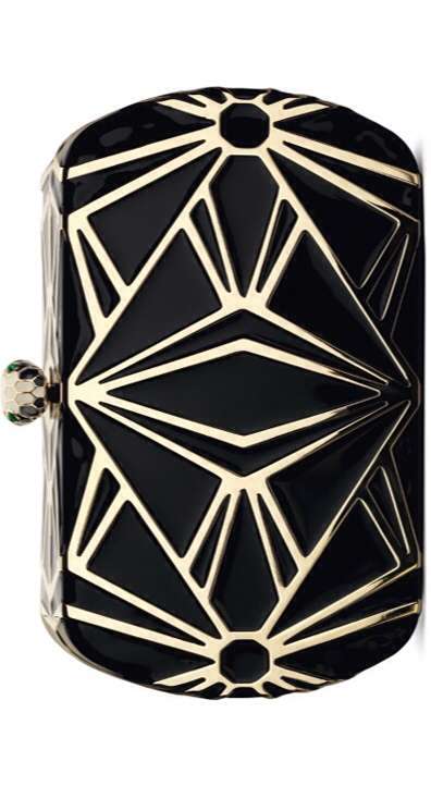 Serpenti minaudière with light gold and black enamel décor. Snake head closure in light gold and enamel finish with malachite eyes by Bulgari | Holiday Color Crush - Gold, Black and Crystal