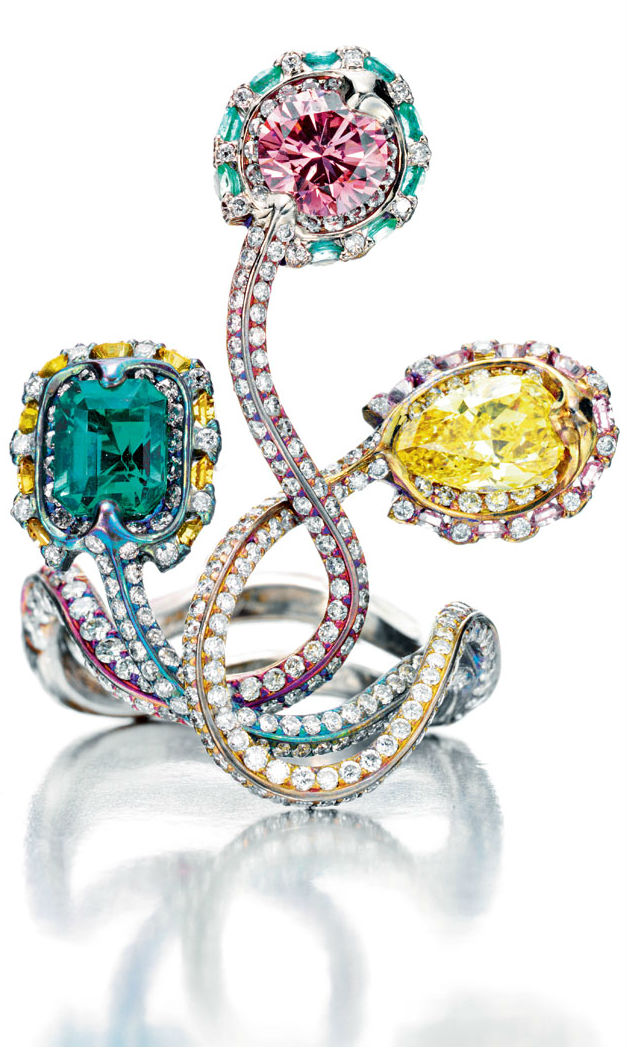 "Wallace Chan ""Snake Trilogy"" Ring featuring fancy pink and yellow diamonds, an emerald in an unusually-shaped colored titanium setting  via Haute Tramp"