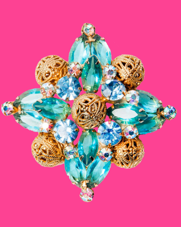 Gold and blue crystal brooch